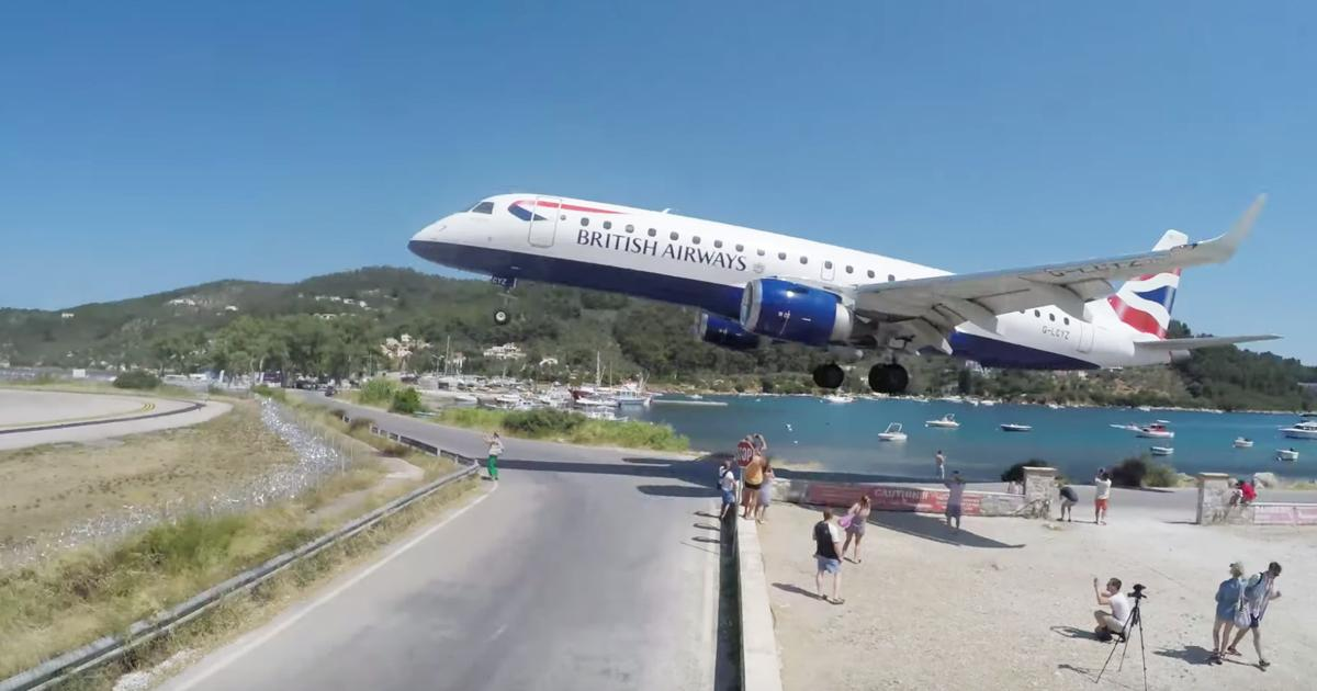Passenger Airplane Misses Tourists By Feet As It Lands At Airport
